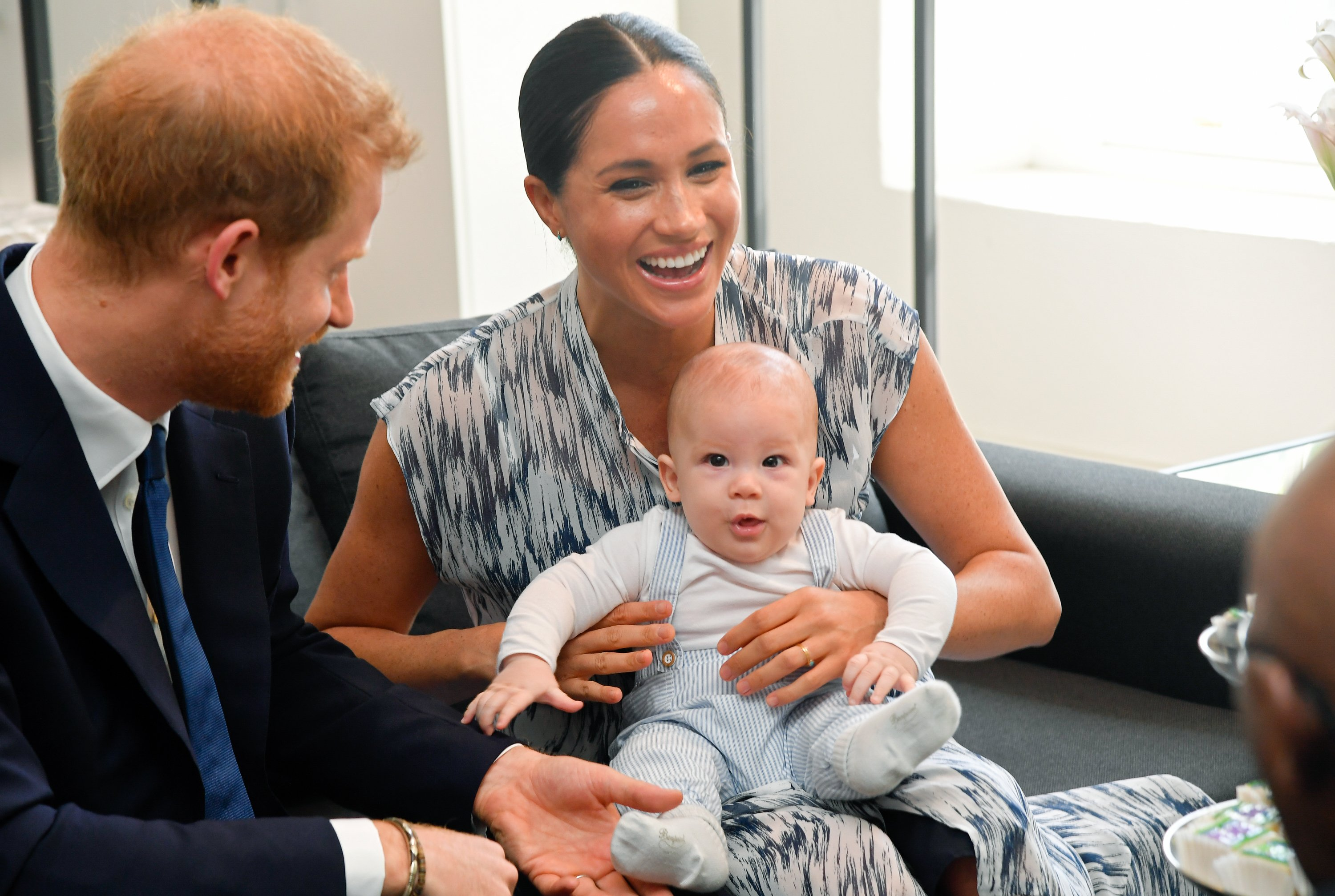 Prince Harry, Meghan Markle and their son Archie Mountbatten-Windsor during a meeting with Archbishop Desmond Tutu  at the Desmond & Leah Tutu Legacy Foundation | Photo: Toby Melville/Pool/Samir Hussein/WireImage