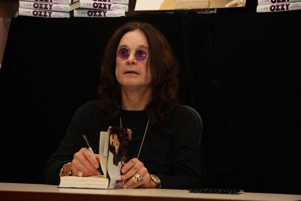 "Ozzy Osbourne signs copies of ""I Am Ozzy"" book. 