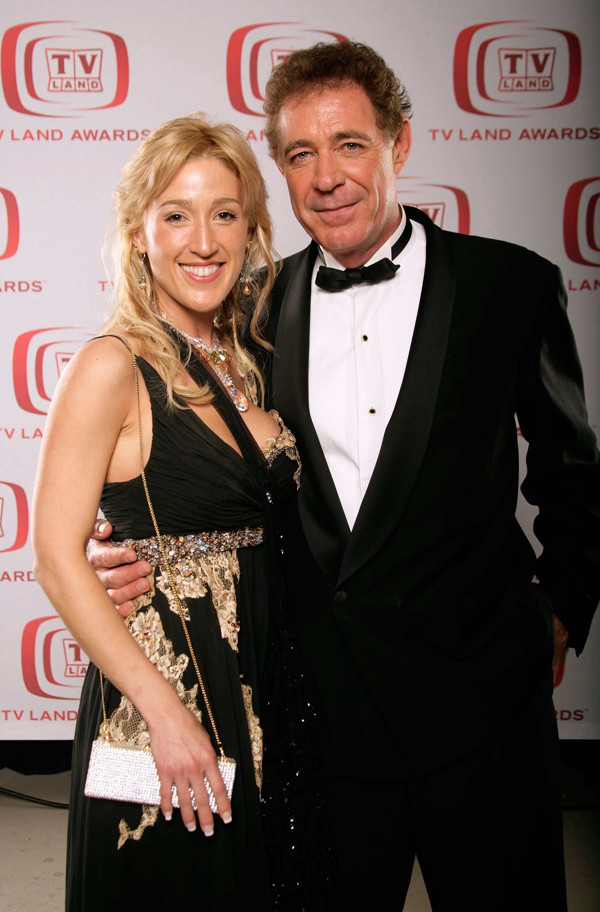"""Barry Williams and Elizabeth Kennedy pose for a portrait during the 6th annual """"TV Land Awards"""" held at Barker Hangar on June 8, 2008, in Santa Monica, California. 