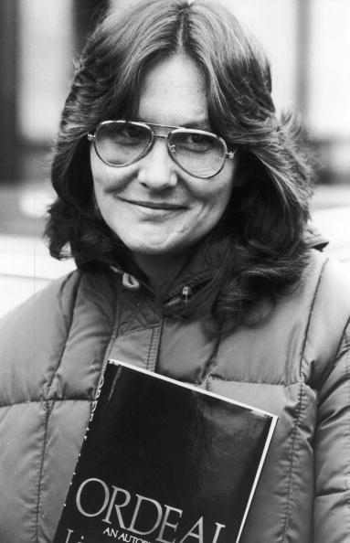 "Linda Lovelace Poses With Her Autobiography ""Ordeal"" April 4, 1981, In England. 