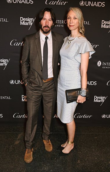Keanu Reeves (L) and artist Alexandra Grant attend the UNAIDS Gala during Art Basel 2016 at Design Miami/ Basel on June 13, 2016 in Basel, Switzerland | Photo: Getty Images
