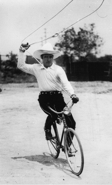 Tom Mix seen riding a bicycle on June 19th 1933. | Photo: Getty Images