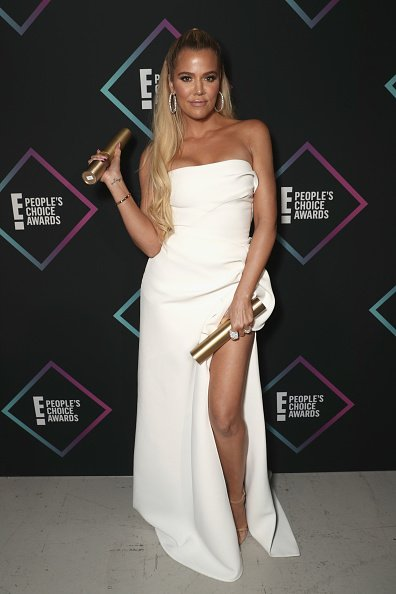 Khloe Kardashian, winner of the Reality Show of 2018 award for 'Keeping Up With The Kardashians' backstage during the 2018 E! People's Choice Awards held at the Barker Hangar | Photo: Getty Images
