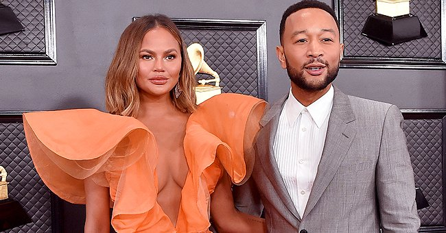 John Legend's Wife Chrissy Teigen Stuns in Orange Ruffled Dress with Plunging Neckline at the 2020 Grammys