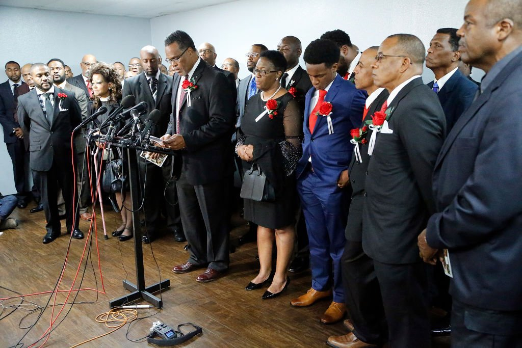 Church members stood with the family of Botham Shem Jean at a press conference after the funeral service at Greenville Avenue Church of Christ | Photo: Getty Images
