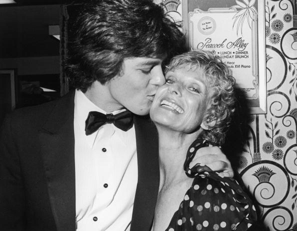 Actress Cloris Leachman being kissed by her son Bryan Englund at unidentified event | Photo: Getty Images