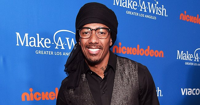 Nick Cannon's Ex Brittany Bell Poses with Her Son & Flaunts Baby Bump in a Red Polka-Dot Dress