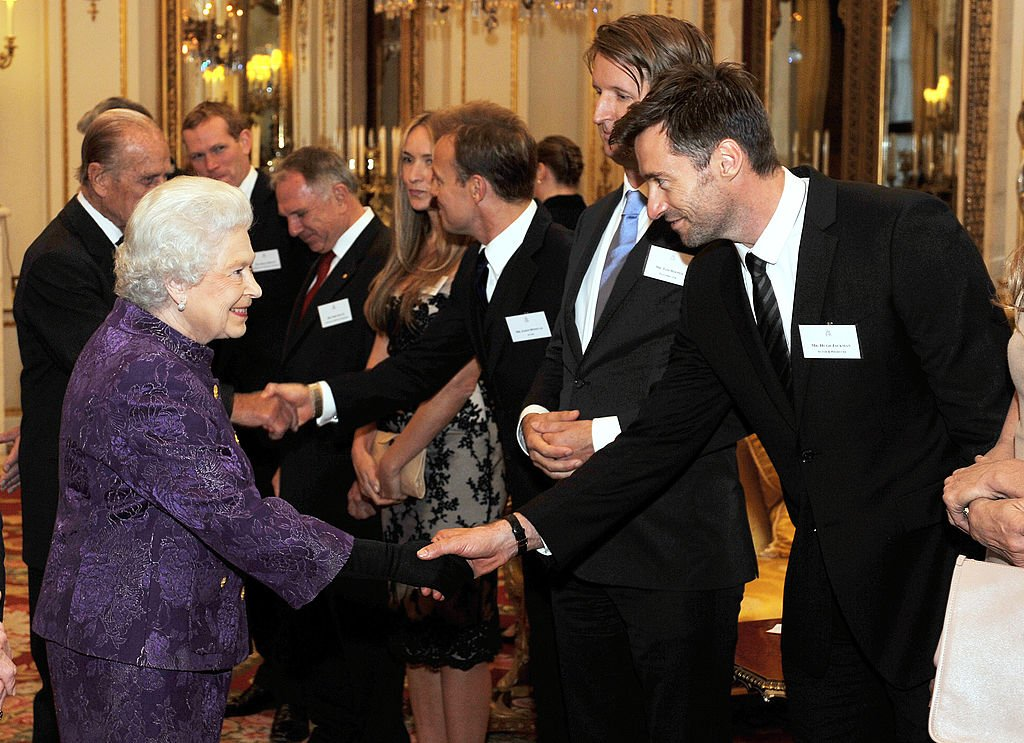 Hugh Jackman shook hands with Queen Elizabeth II at Buckingham Palace, in London, 2011.   Source: Getty Images