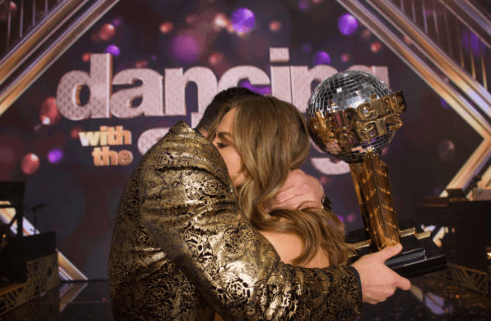 "Alan Bersten and Hannah Brown hug as they are announced the winners for season 28 of ""Dancing with the Stars,"" on November 25, 2019 