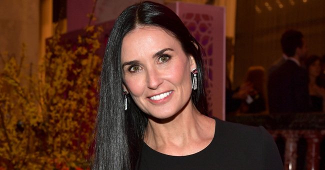 Demi Moore, 57, Shows off Age-Defying Beauty in Black Sweatsuit as She Poses with Her Dog