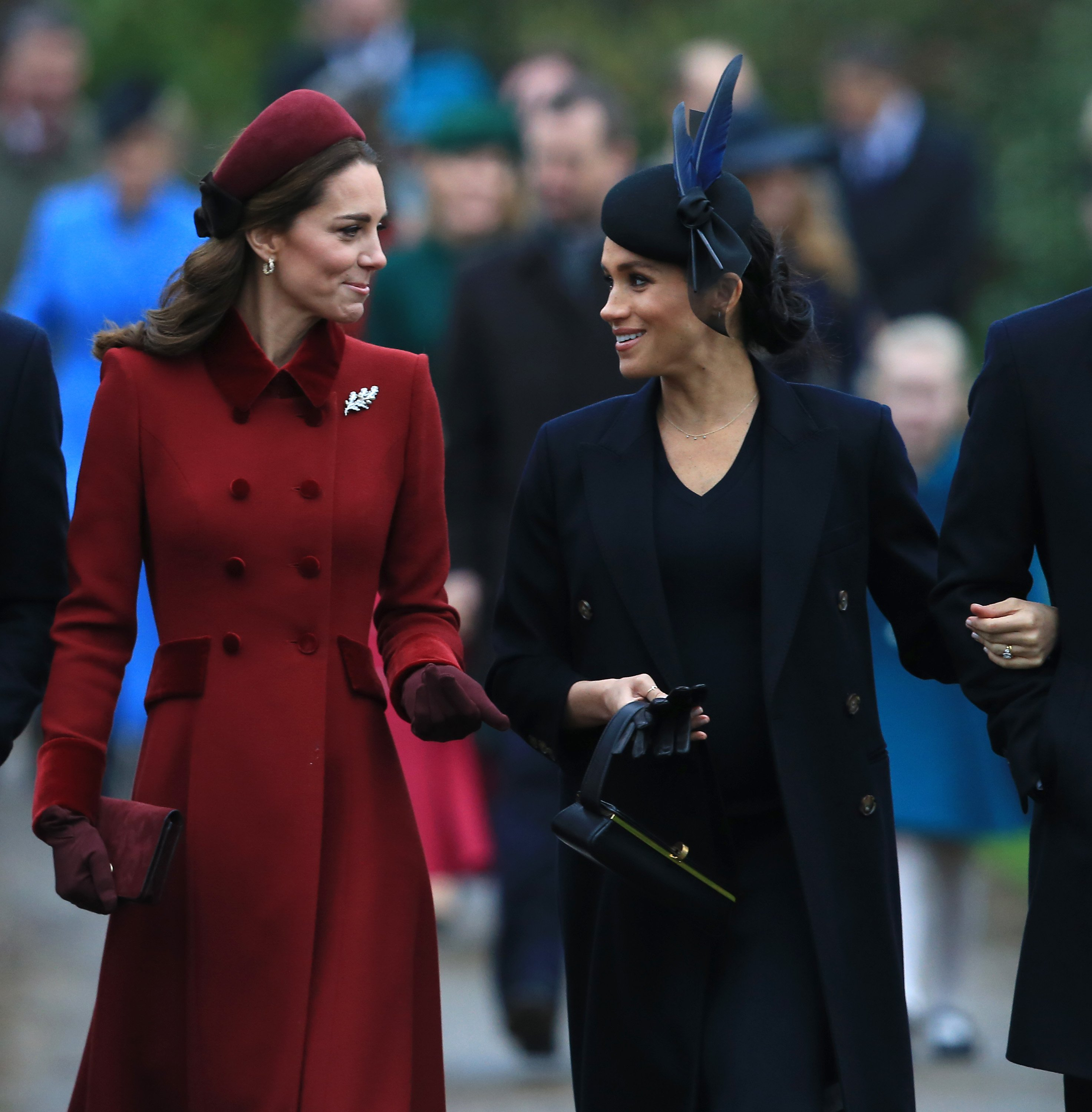 Kate Middleton and Meghan Markle at an event making conversation | Photo: Getty Images