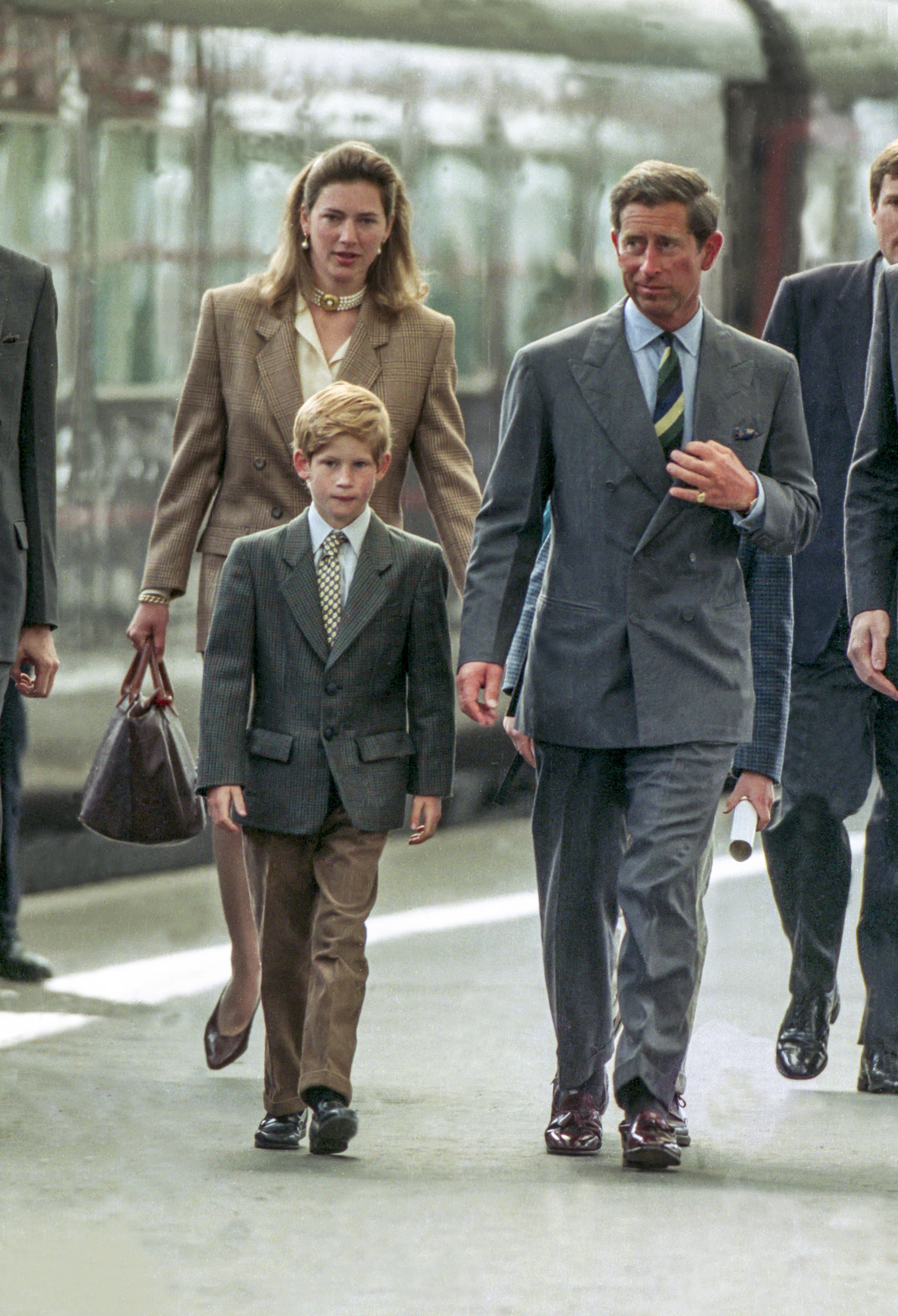 Charles, Prince of Wales, and Prince Harry, with nanny, Tiggy Legge Bourke, arrive at Aberdeen Railway Station on August 17, 1993 in Aberdeen, Scotland   Photo: Getty Images