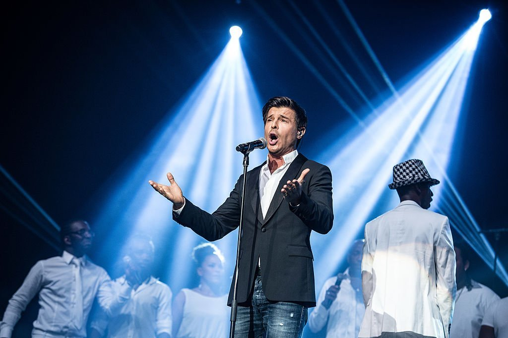 Vincent Niclo se produit à l'Olympia le 12 septembre 2013 à Paris, France. | Photo : Getty Images.
