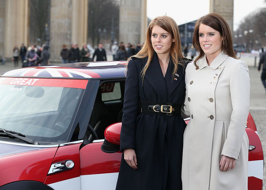 Princess Beatrice and Princess Eugenie pose next to a Mini in front of Brandenburg Gate on January 17, 2013 in Berlin, Germany.   Photo: Getty Images