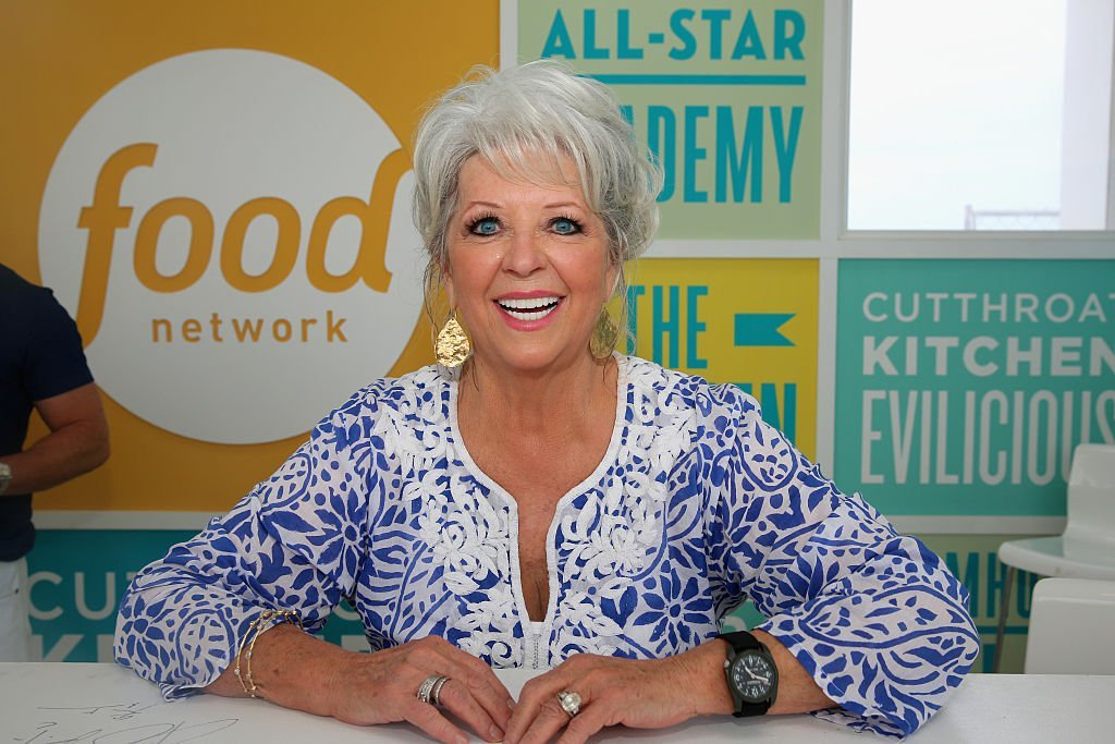 Paula Deen signing books at the Food Network & Cooking Channel South Beach Wine & Food Festival at Grand Tasting Village on February 22, 2015 in Miami Beach, Florida | Photo: Getty Images