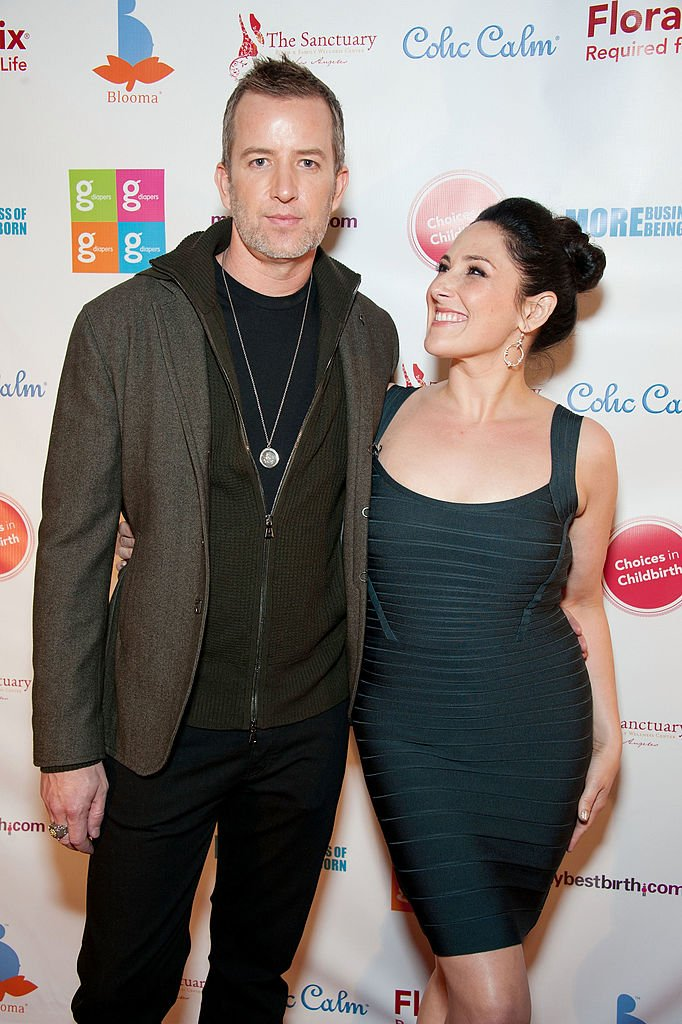 """Ricki Lake (R) and Christian Evans arrive at the Los Angeles premiere of """"More Business of Being Born"""" at Laemmle's Royal Theatre on November 9, 2011 in Los Angeles, California. 