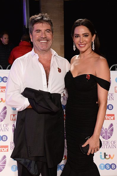 Simon Cowell and Lauren Silverman attend the Pride of Britain Awards 2018 at The Grosvenor House Hotel on October 29, 2018, in London, England. | Source: Getty Images.