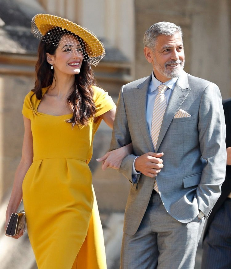 George and Amal Clooney at Duchess Meghan and Prince Harris' wedding in Windsor, May 2018 | Source: Getty Images