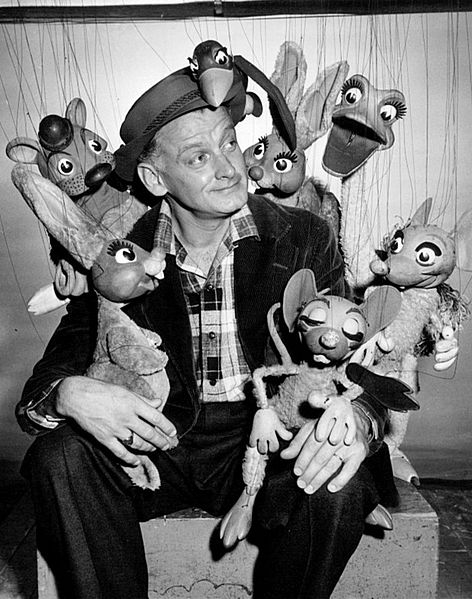 "Photo of Art Carney with Bil Baird's puppets for a television production of ""Peter and the Wolf."" 