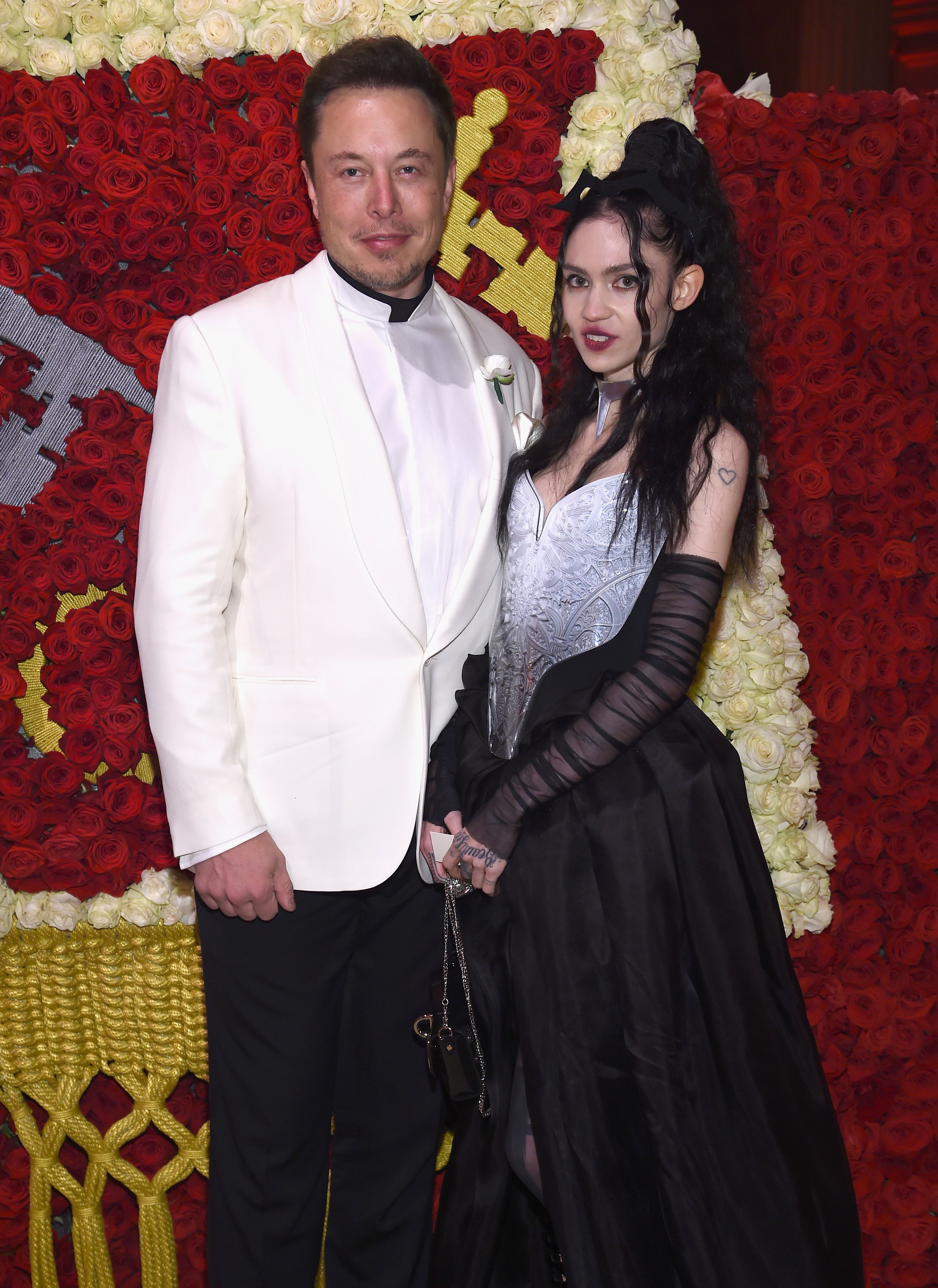 Elon Musk and Grimes at the Heavenly Bodies Gala on May 7, 2018, in New York City. | Source: Getty Images.