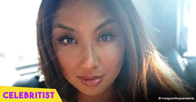 Jeannie Mai shows off leg tattoo and fuller curves in leather skirt and high heels
