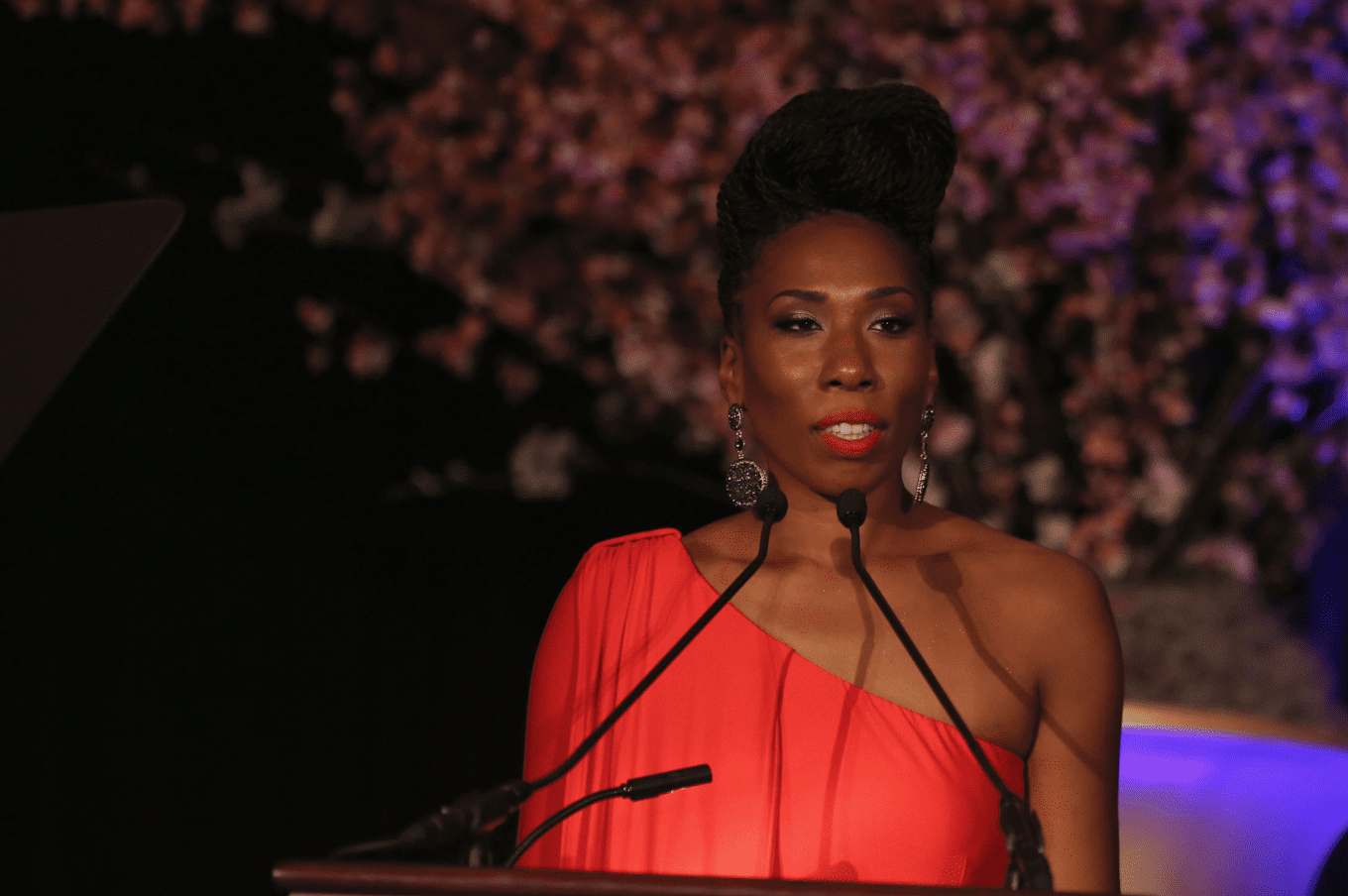 "Brandi Harvey stands behind a podium during her speech at the ""Steve & Marjorie Harvey Foundation Gala"" on May 3, 2014, in Chicago, Illinois. 