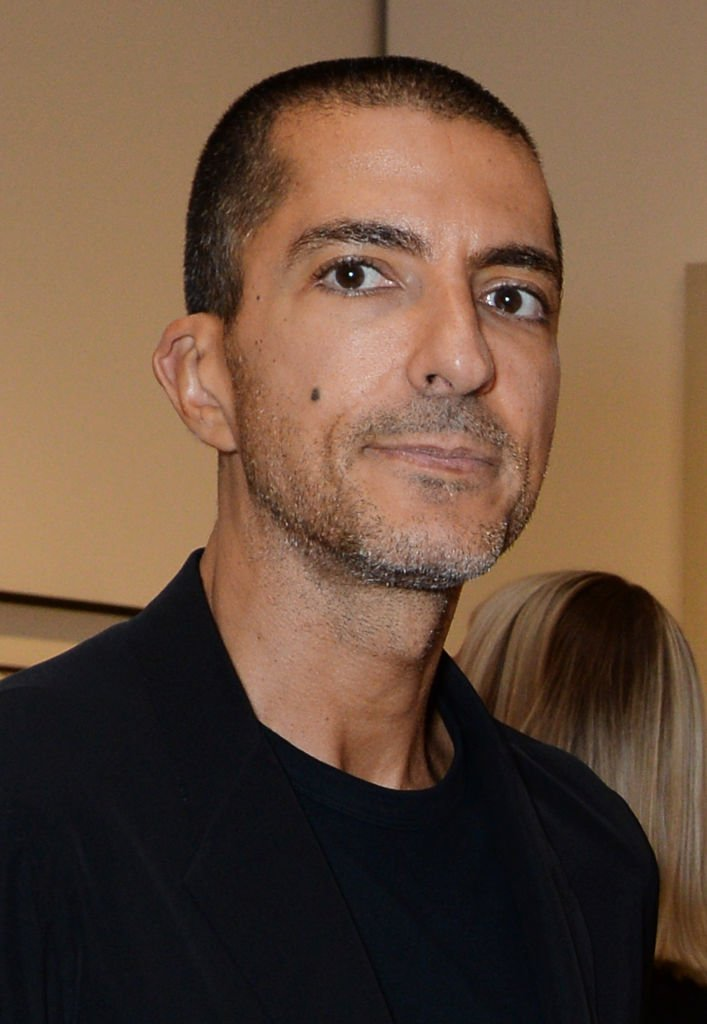 """Wissam Al Mana at the Bansky 'Greatest Hits 2002-2008"""" exhibition on July 9, 2018, in London, England 