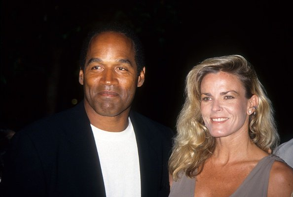 "O.J. Simpson & Nicole Brown Simpson pose at the premiere of the ""Naked Gun 33 1/3: The Final Isult"" on Mar. 16, 1994 in Los Angeles, California. 