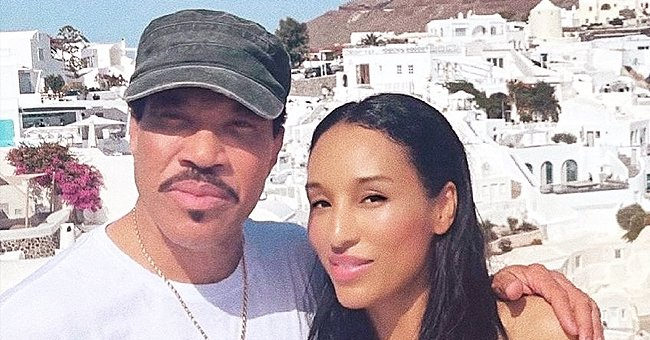 Lionel Richie's Beloved Woman Lisa Poses Barefoot in a White Dress on Stone Stairs during Their Trip