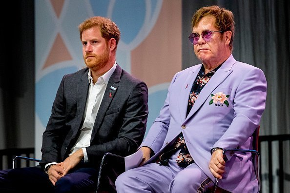 Sir Elton John and Prince Harry, Duke of Sussex at the  International AIDS Conference on July 24, 2018 in Amsterdam, Netherlands.| Photo:Getty Images