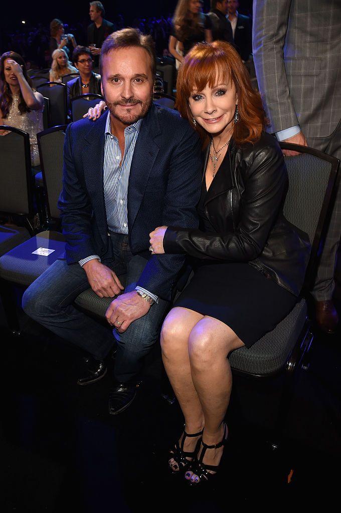 Narvel Blackstock and Reba McEntire at the American Country Countdown Awards at Music City Center on December 15, 2014 | Photo: Getty Images