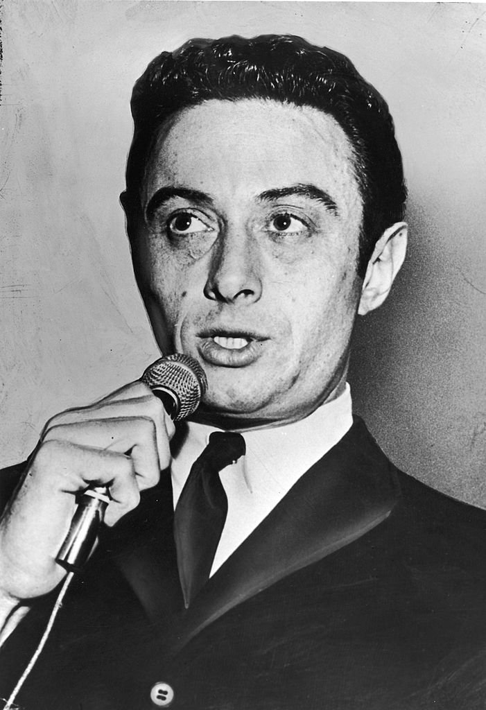 American comedian Lenny Bruce (1925 - 1966) holds a microphone while performing, circa 1950.   Photo: Getty Images