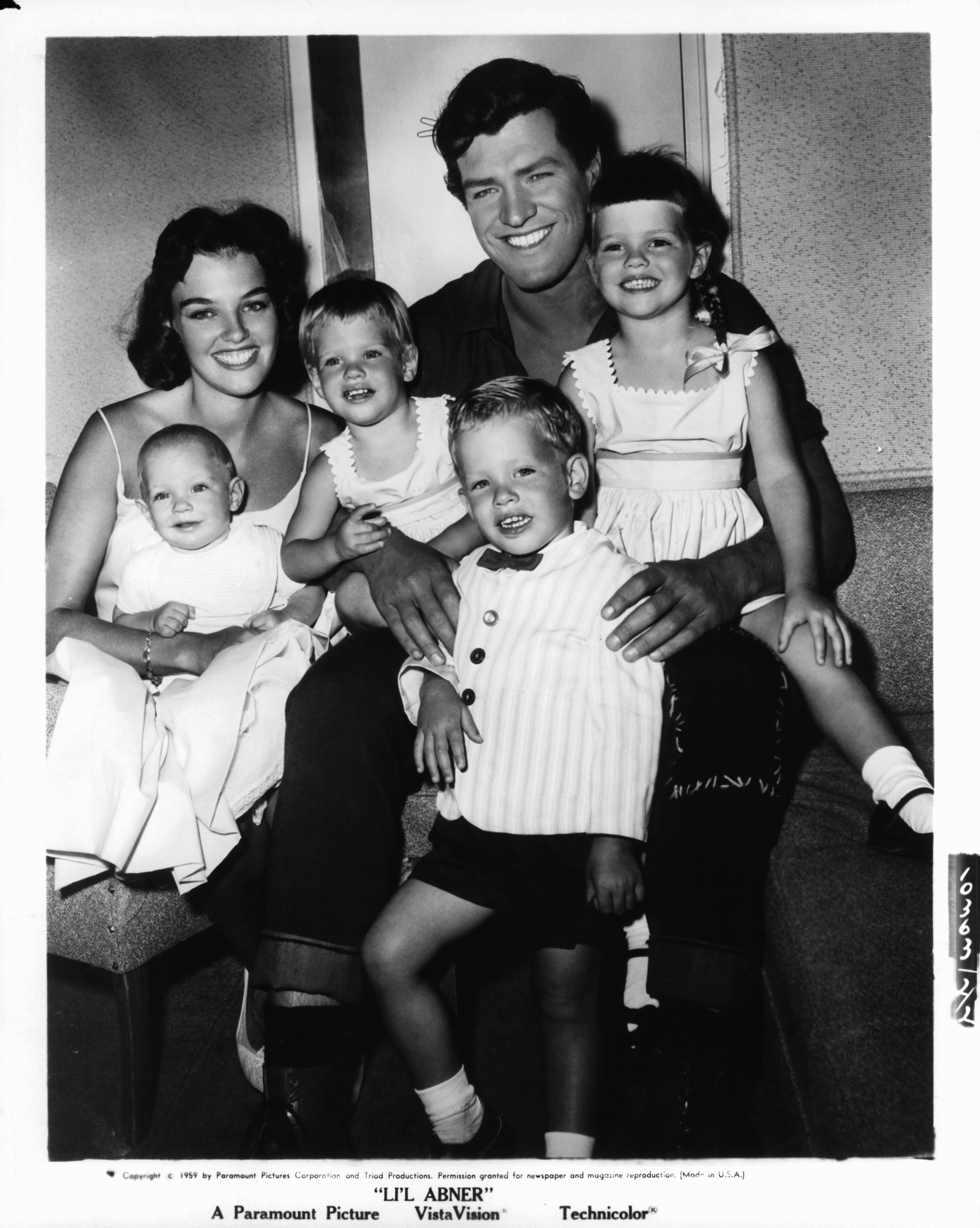 """Peter Palmer with his wife Jackie and children Kathleen, Sherri, Mike, and Scott in a publicity portrait for the film """"Li'l Abner"""" in 1959   Photo: Paramount/Getty Images"""