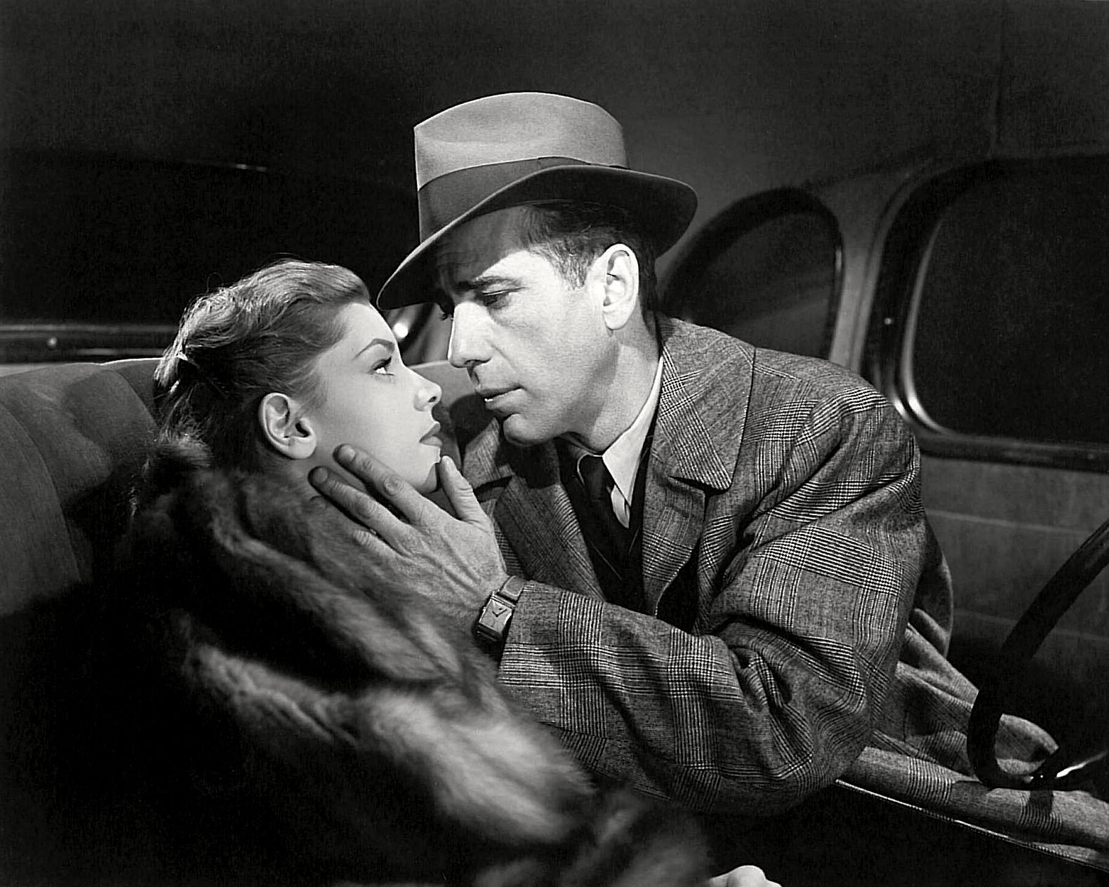"Publicity photo of Lauren Bacall & Humphrey Bogart in American noir film ""The Big Sleep."" 