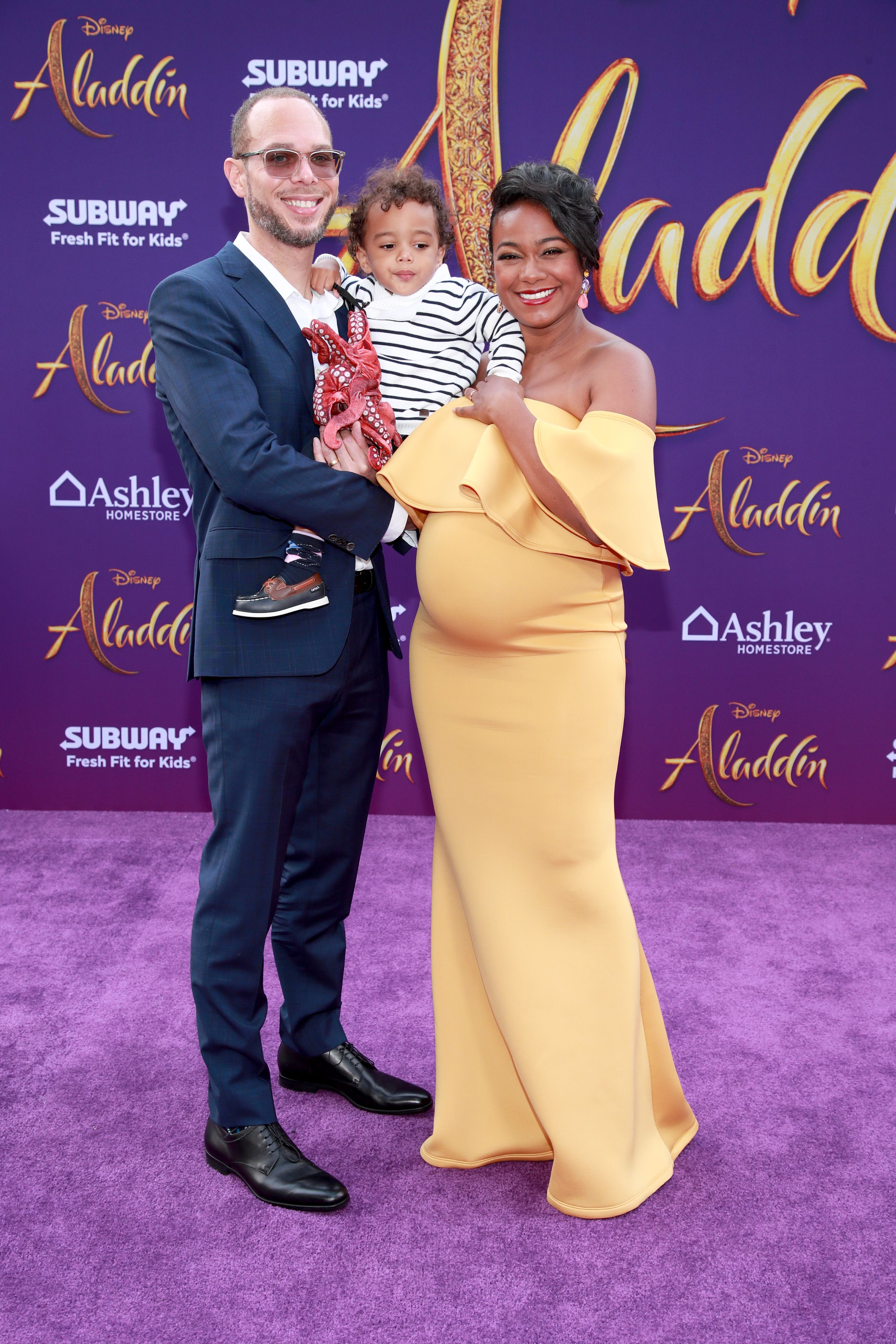 """Tatyana Ali, husband Vaughn Rasberry, and son Edward at the premiere of """"Aladdin"""" in 2019 in Los Angeles 