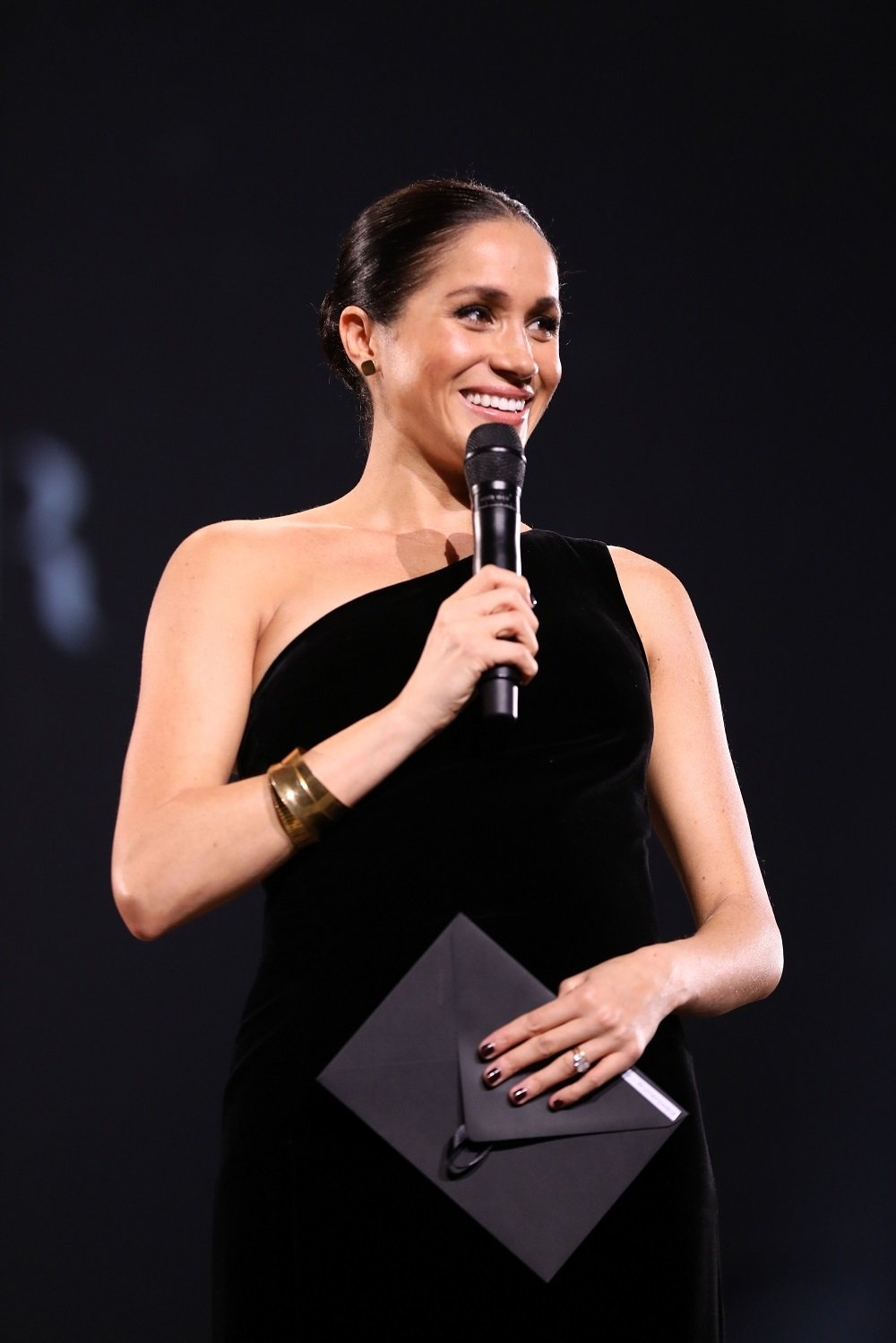 Duchess Meghan on stage during The Fashion Awards In Partnership With Swarovski on December 10, 2018, in London, England | Photo: Tristan Fewings/BFC/Getty Images