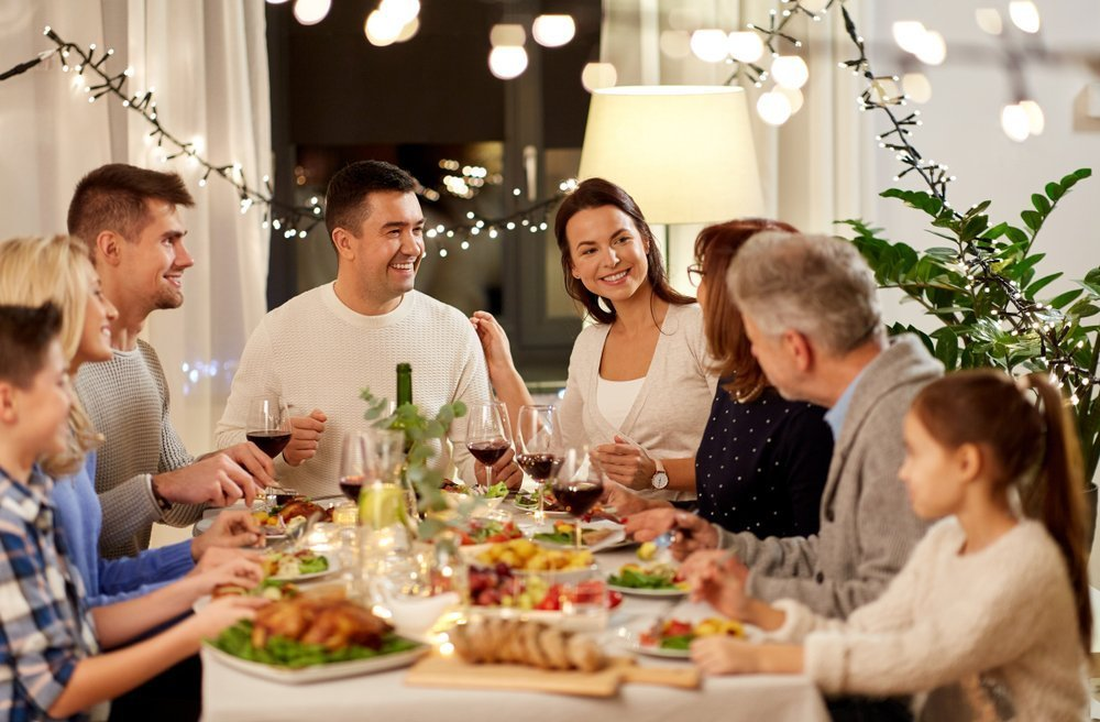 Happy family having Thanksgiving dinner party at home. | Photo: Shutterstock
