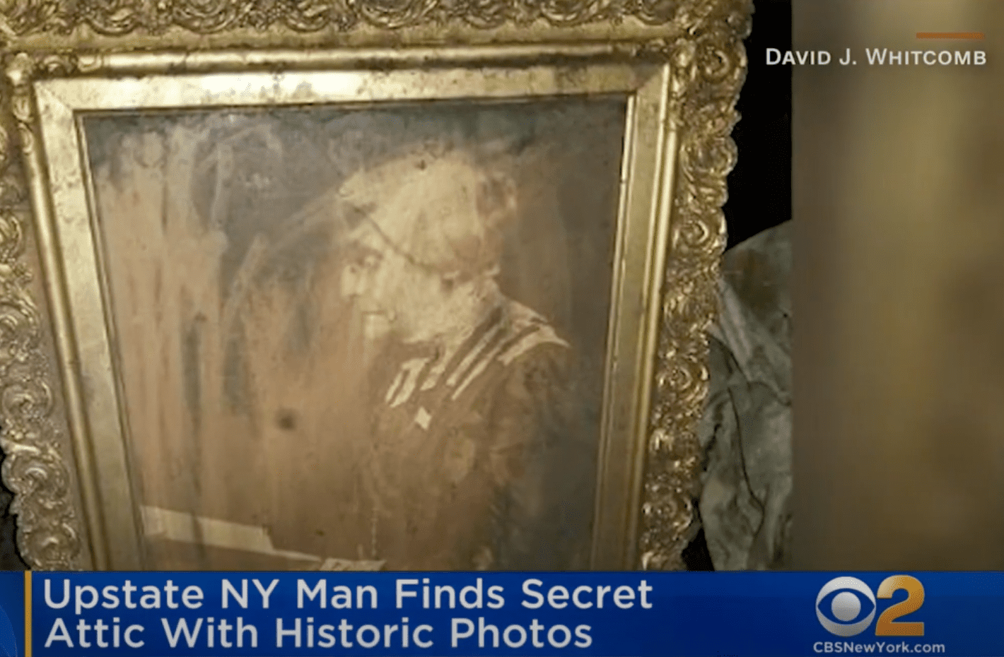 In a hidden attic in New York, a man found an old framed photograph of Susan B. Anthony | Photo: Youtube/CBS New York