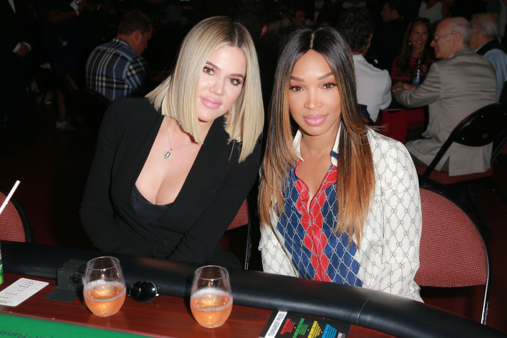 """Khloe Kardashian (L) and Malika Haqq attend the first annual """"If Only"""" Texas hold'em charity poker tournament benefiting City of Hope at The Forum on July 29, 2018 