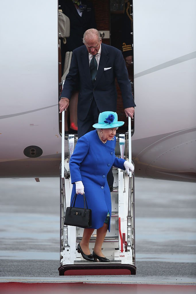 Queen Elizabeth II and Prince Philip, the Duke of Edinburgh, emerge from their plane as they arrive at Tegel airport on the first of their four-day visit to Germany on June 23, 2015, in Berlin, Germany. | Source: Getty Images.