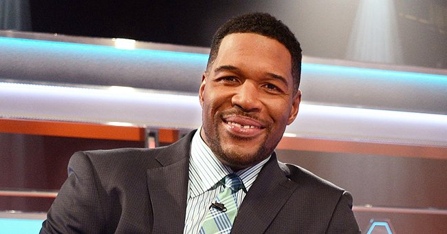 Michael Strahan's Twin Daughters Pose in Masks While Walking Their Family Dog (Photos)