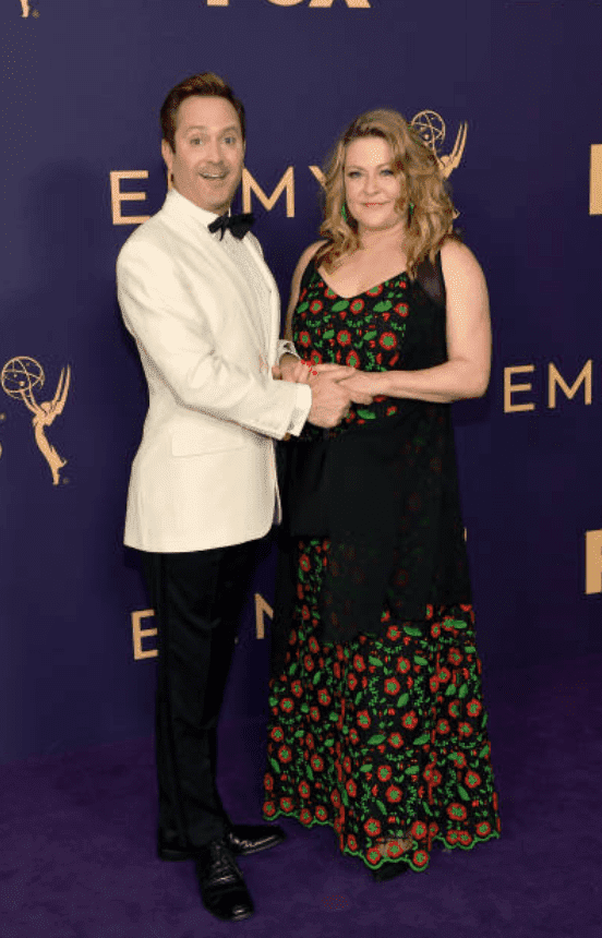 Thomas Lennon and Jenny Robertson pose on the purple carpet at the 71st Emmy Awards on September 22, 2019, in Los Angeles, California | Source: Getty Images