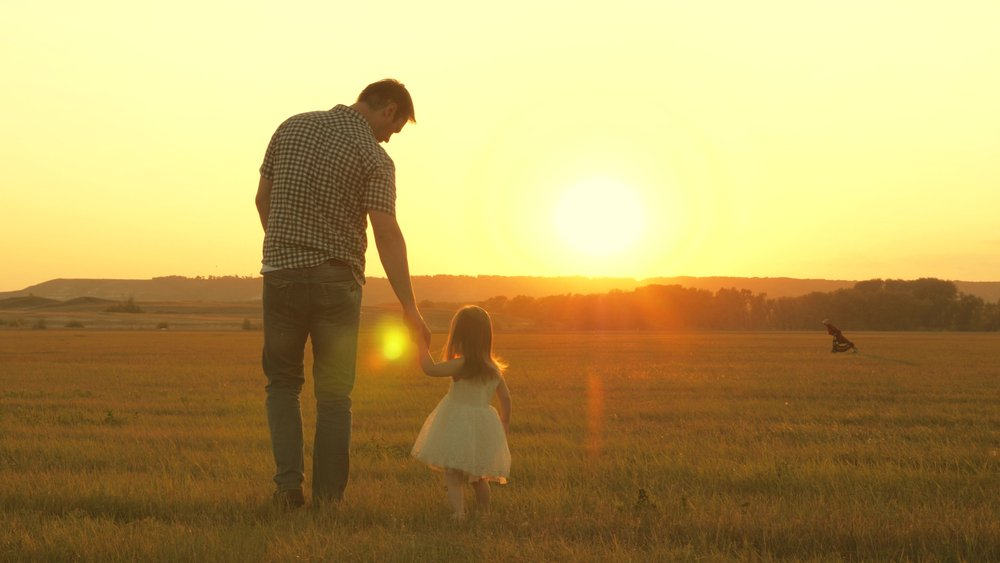 A photo of a father taking a walk with his daughter | Photo: Shutterstock
