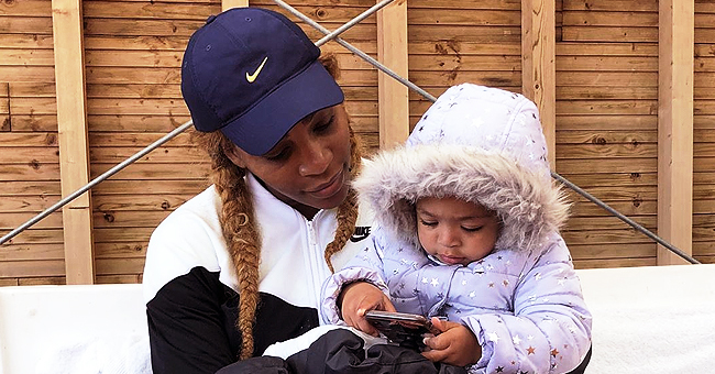 Serena Williams Cuddles with Daughter Olympia Dressed in a Puffy Jacket (Photo)
