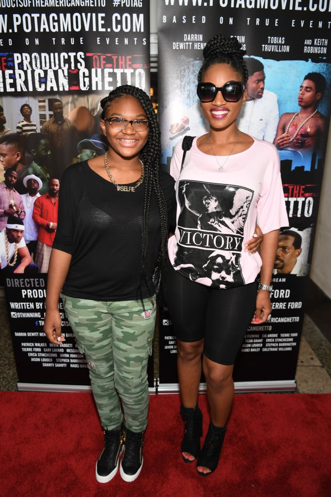 """Erica Dixon and daughter, Emani Richardson at """"The Products Of The American Ghetto"""" Atlanta Screening at The Plaza Theatre on August 23, 2017 