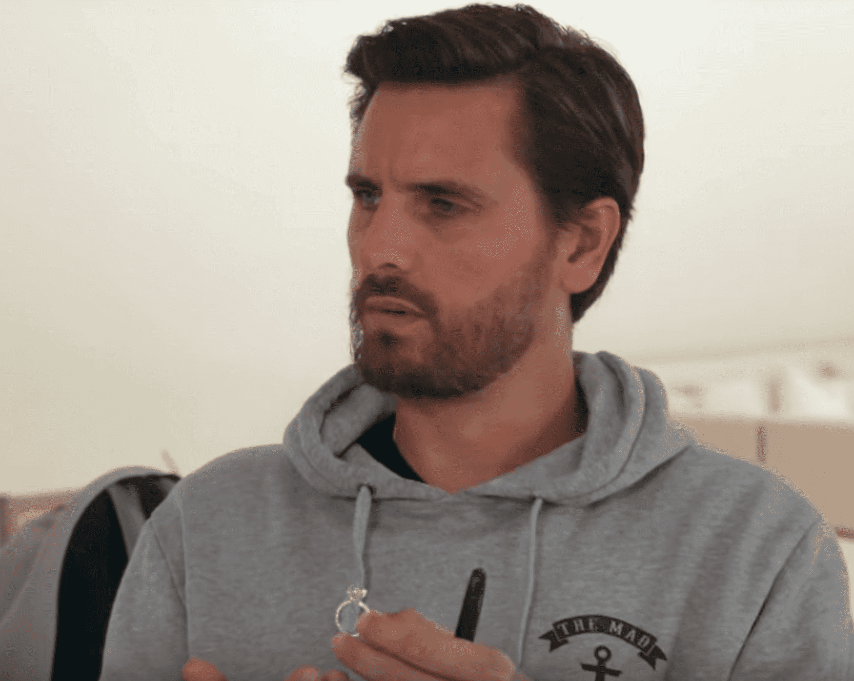 Scott Disick holds the ring given to Khloé by her ex Tristan Thompson. | Source: YouTube/KeepingUpWithTheKardashians
