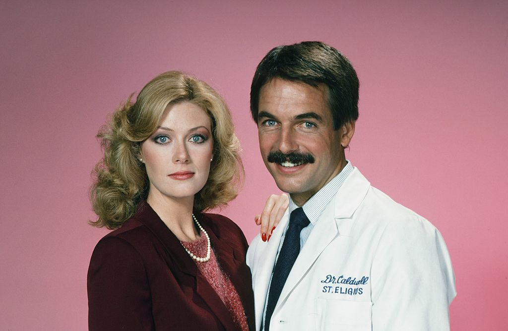 "Nancy Stafford as Joan Halloran, Mark Harmon as Doctor Robert Caldwell on the set of ""St. Elsewhere"" on March 03, 2012 
