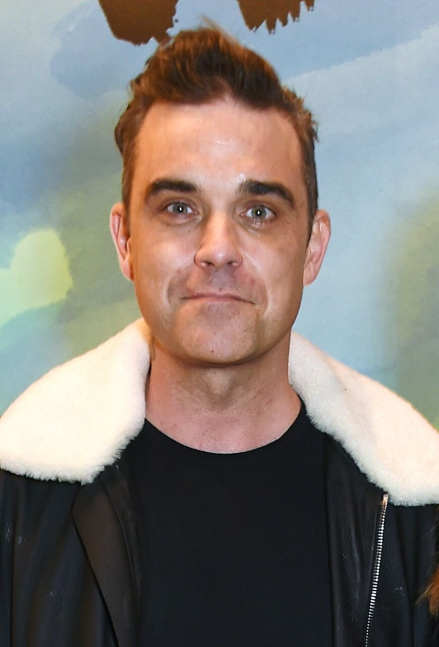 Robbie Williams attends a private view of the David Hockney retrospective at the Tate Britain. | Source: Getty Images