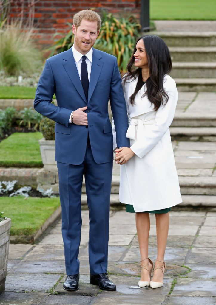 Prince Harry and Meghan Markle during an official photocall to announce the engagement of Prince Harry and actress Meghan Markle at The Sunken Gardens at Kensington Palace  | Getty Images