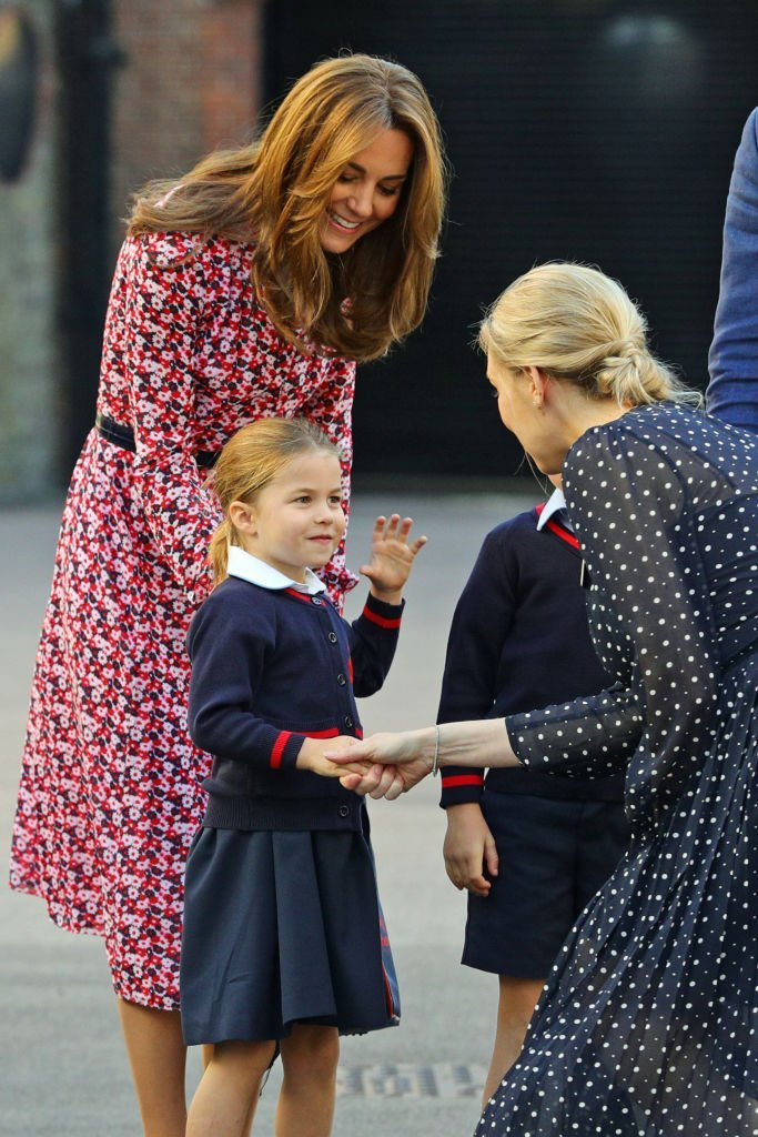 Princess Charlotte and her mother Kate Middleton as they greet a school staff on Charlotte's first day at Thomas's Battersea.| Source: Getty Images